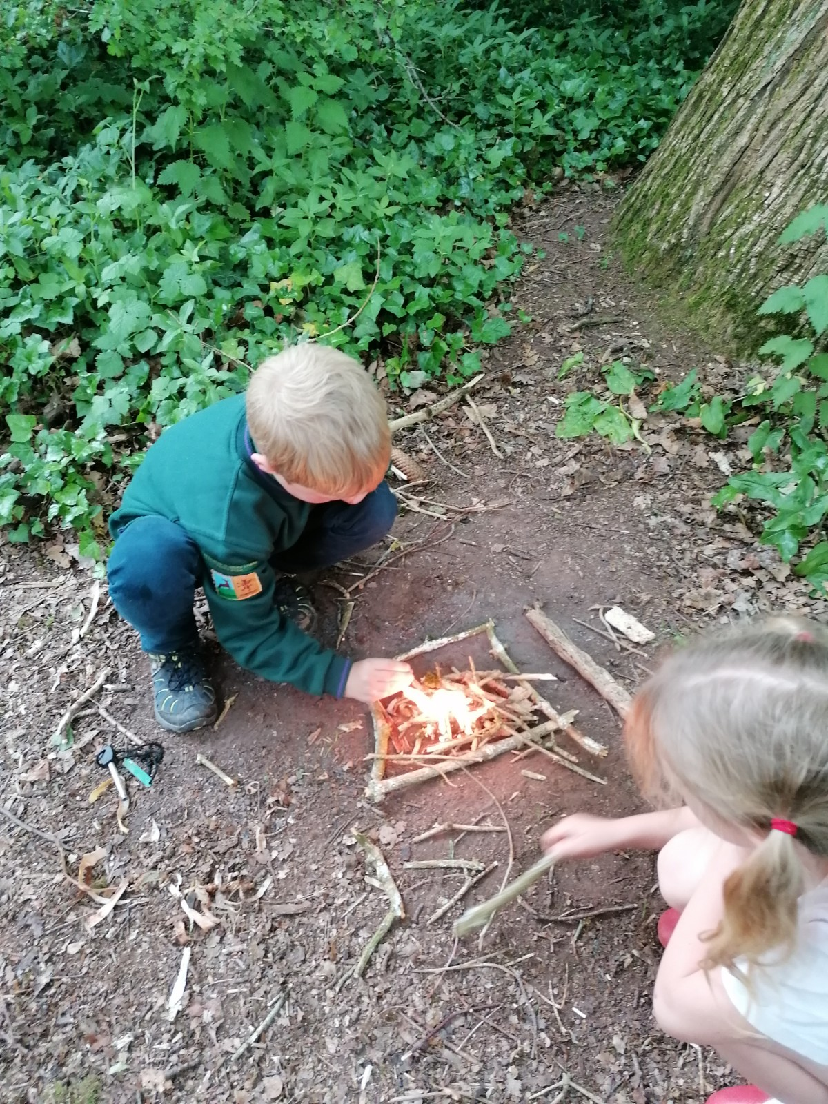 Acorn Cubs learn about building fires, May 2019